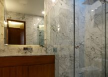 Contemporary-bathroom-in-stone-with-corner-glass-shower-area-217x155