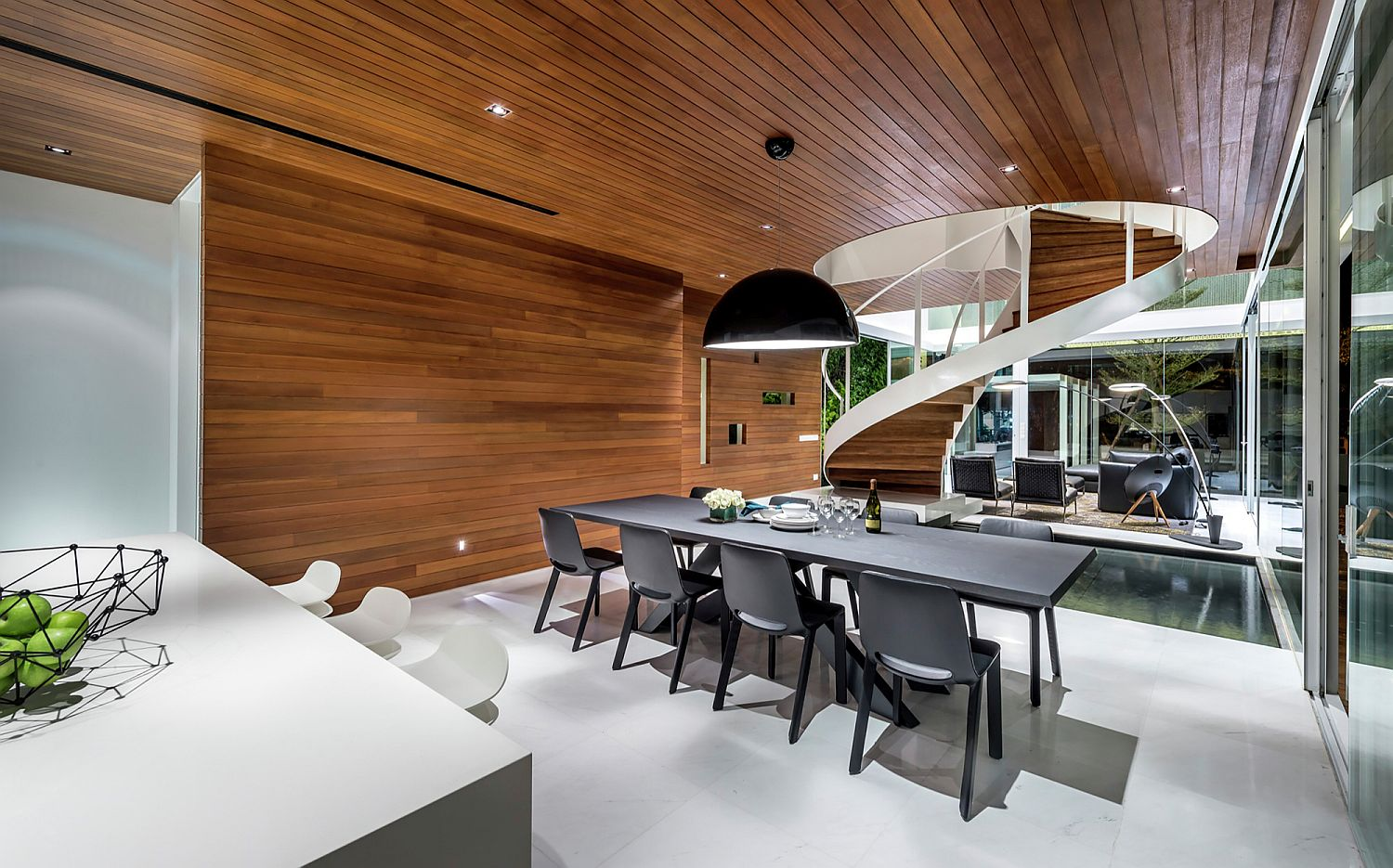 Dining area and kitchen of the house with wooden ceiling