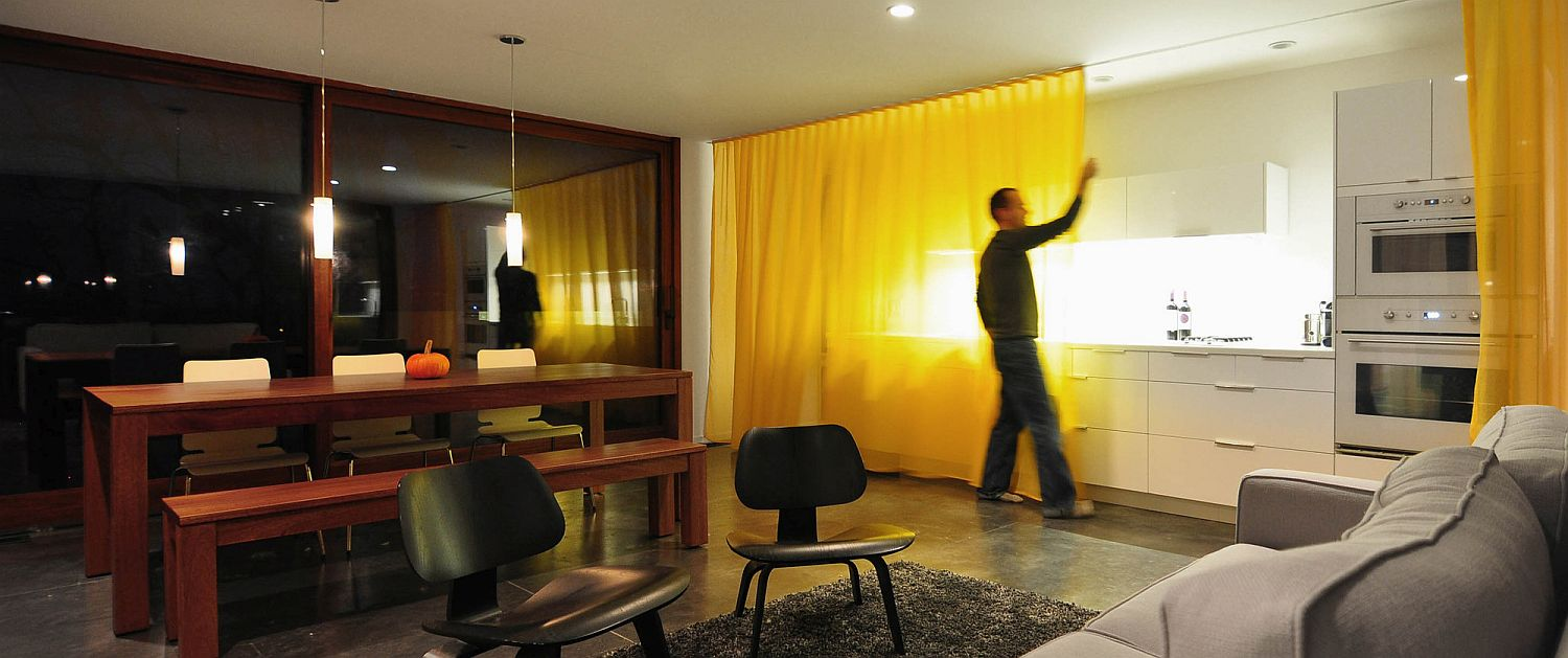 Floor-to-ceiling drapes on either side of the living area help in increasing privacy