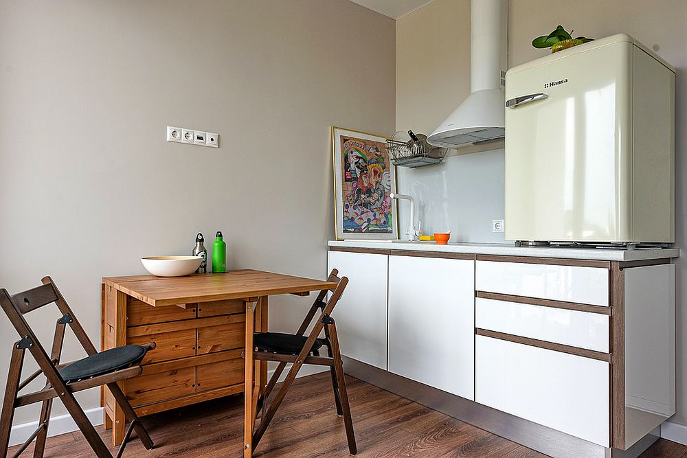 Folding table coupled with twin chairs inside the small kitchen shapes a smart breakfast zone