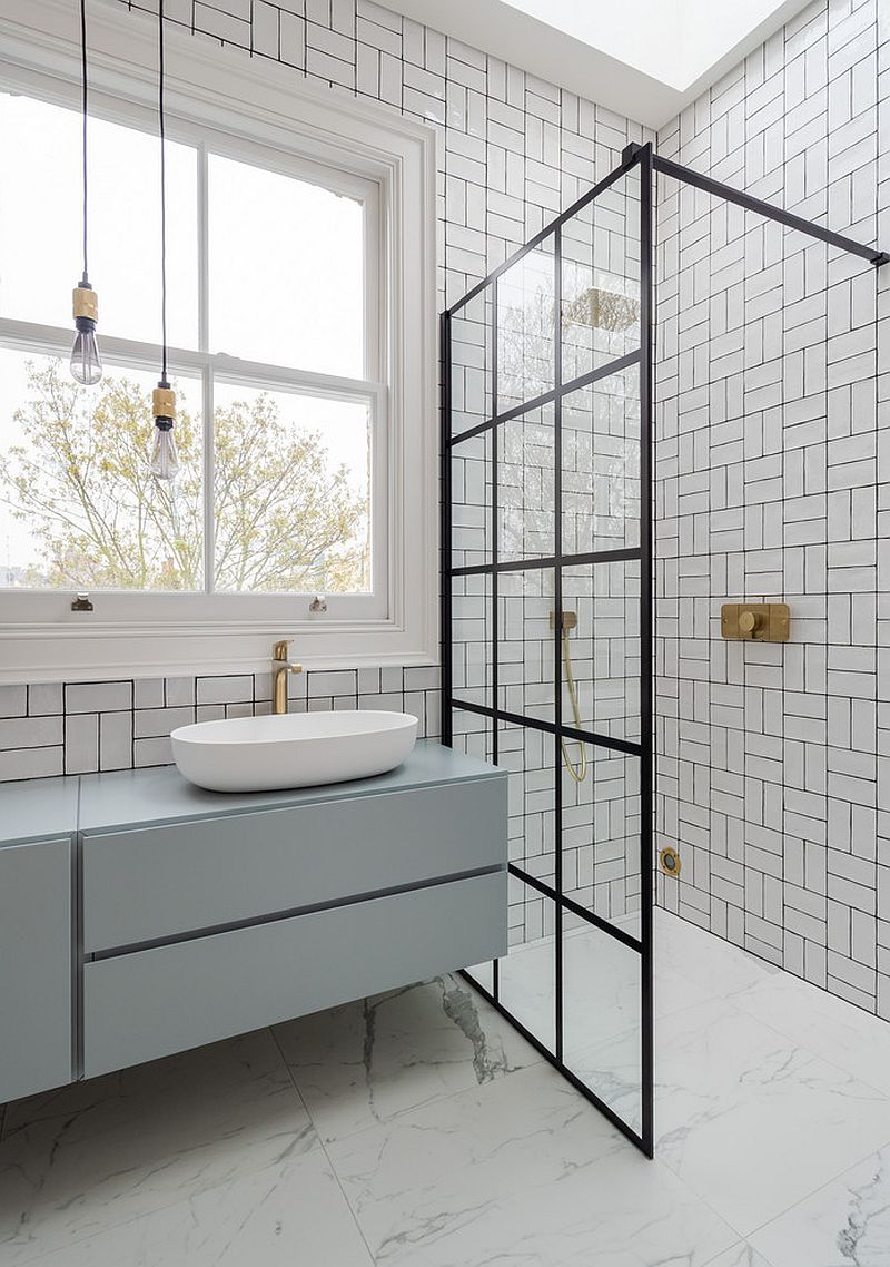 Glass shower area of the bathroom ushers in a hint of black