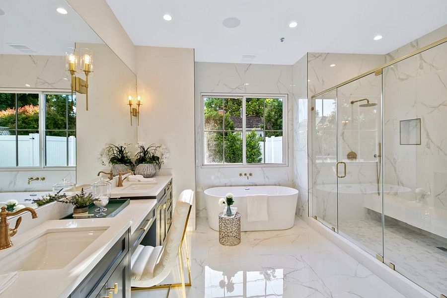 Gorgeous bathroom of LA home with golden accents and ample space