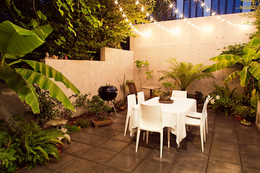 Gorgeous string lighting illuminates the outdoor dining space beautifully