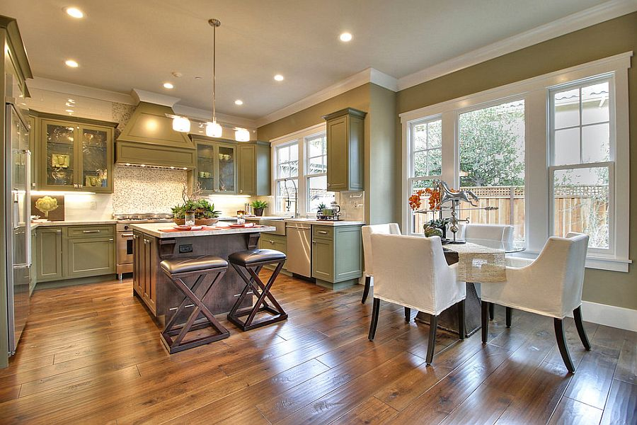 Green modern kitchen with a small dining area feels stylish and spacious