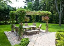 Greenery-pergola-and-a-private-garden-provide-the-perfect-setting-for-an-outdoor-dining-space-217x155
