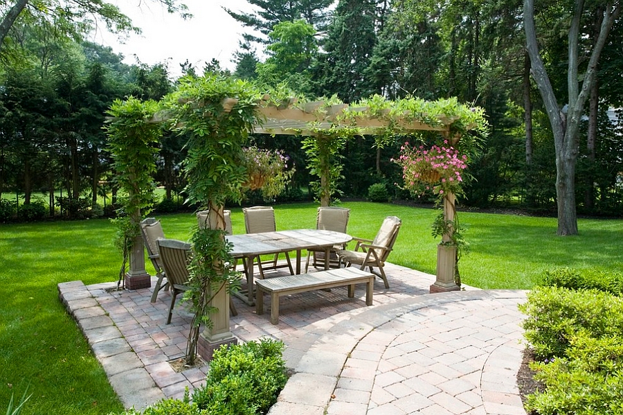 Greenery-pergola-and-a-private-garden-provide-the-perfect-setting-for-an-outdoor-dining-space