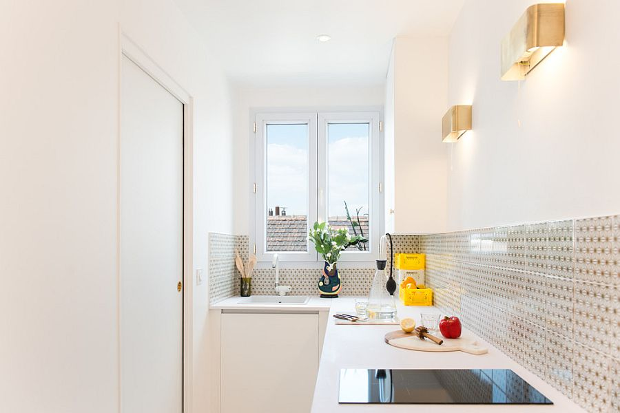 Innovative-use-of-sconce-lights-in-the-tiny-white-kitchen