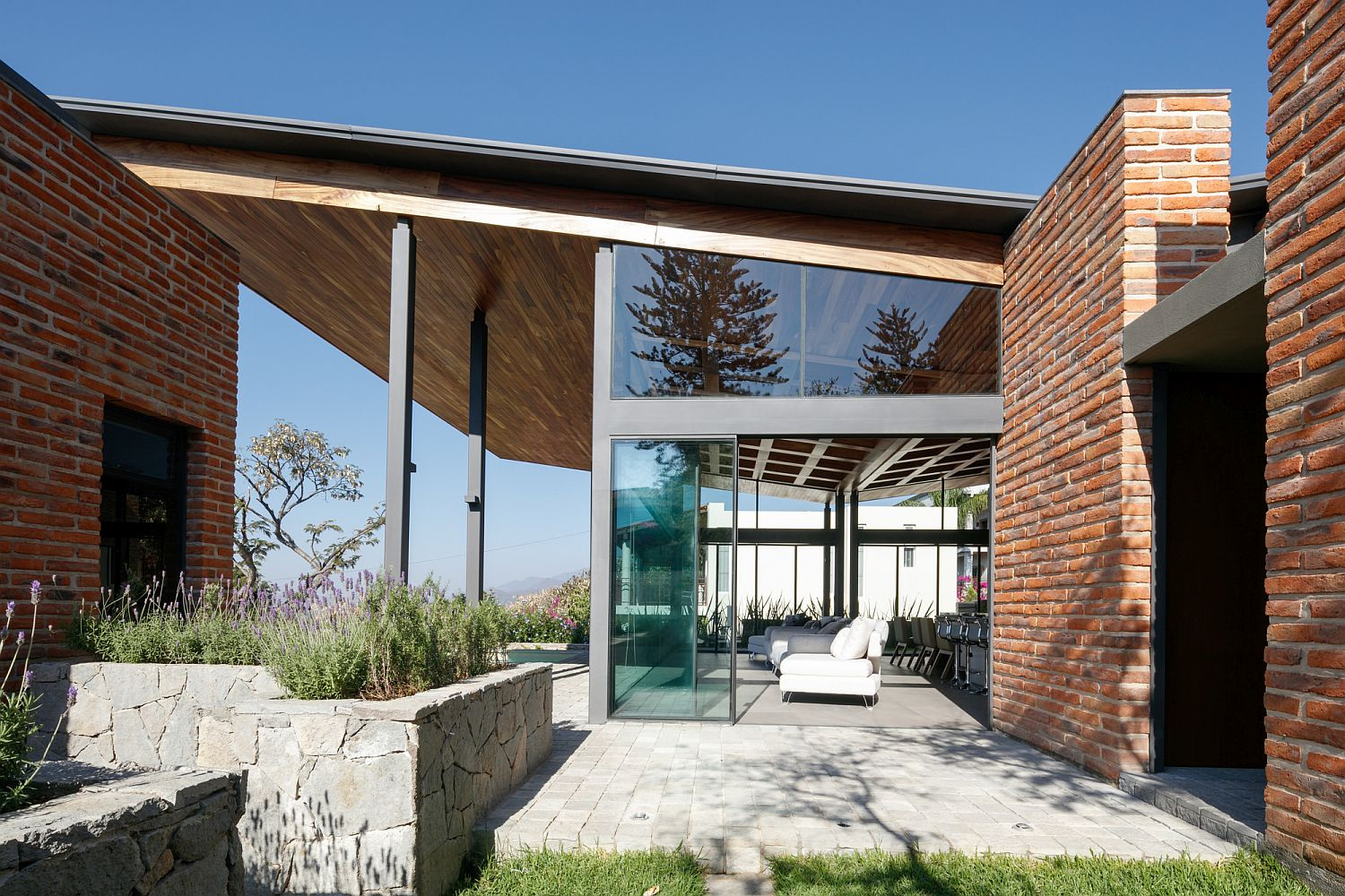 Locally-sourced-materials-coupled-with-brick-to-create-a-cool-urban-home
