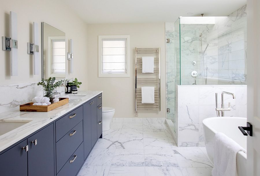 Luxurious bathroom in white with vanity in dark bluish-gray