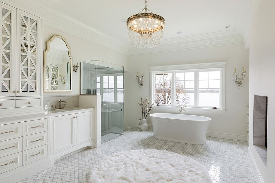 Natural lighting coupled with beautiful chandelier in the large bathroom in white