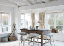 Natural-wood-table-and-white-backdrop-for-the-coastal-dining-space-217x155