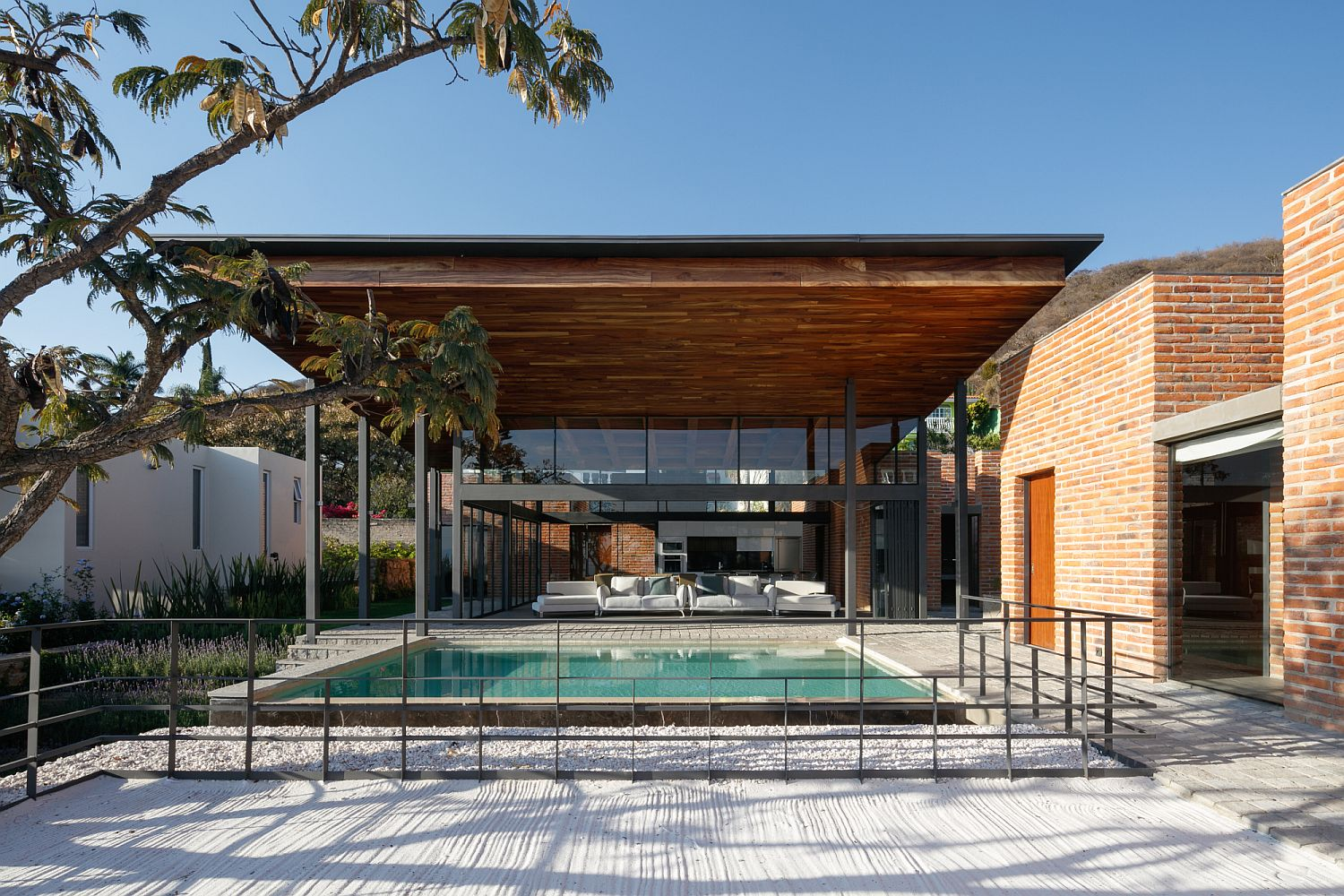 Outdoor pool and deck of the home with ample modern charm
