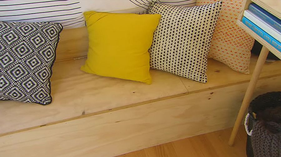 Pillows add color and style to the woodsy cabin interior
