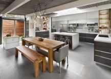 Polished-kitchen-in-gray-with-natural-wood-dining-table-217x155