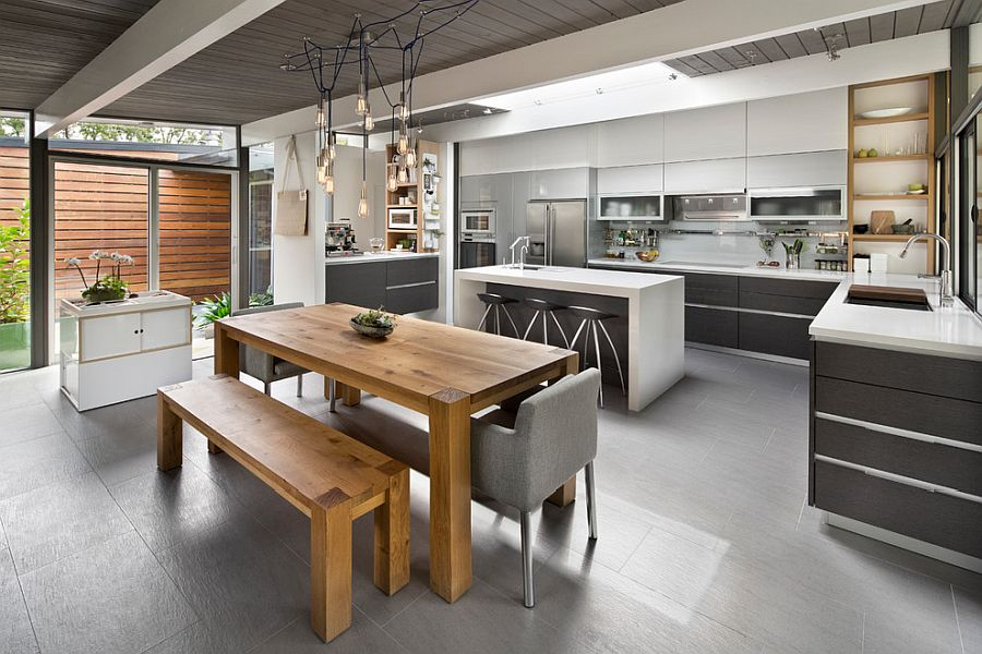 Polished kitchen in gray with natural wood dining table