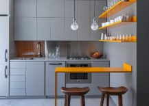 Posh-contemporary-kitchen-in-gray-with-twin-pendants-above-the-counter-217x155