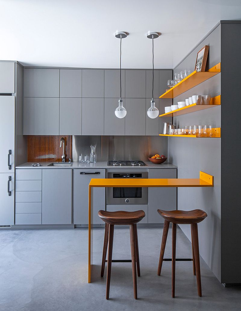 Posh contemporary kitchen in gray with twin pendants above the counter