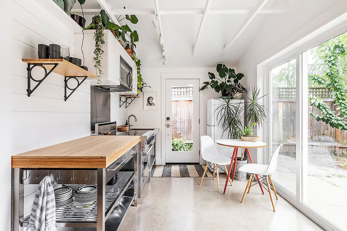 Sliding glass doors connect the kitchen with the outdoors as breezy beach style sets the tone