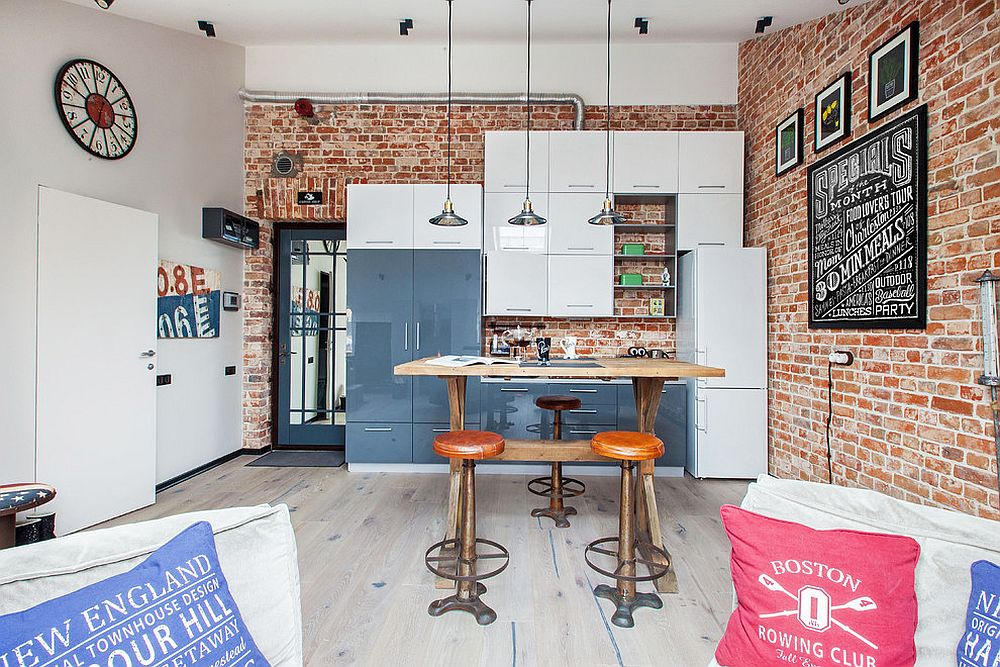 Small modern industrial kitchen with brick wall backdrop and smart pendants