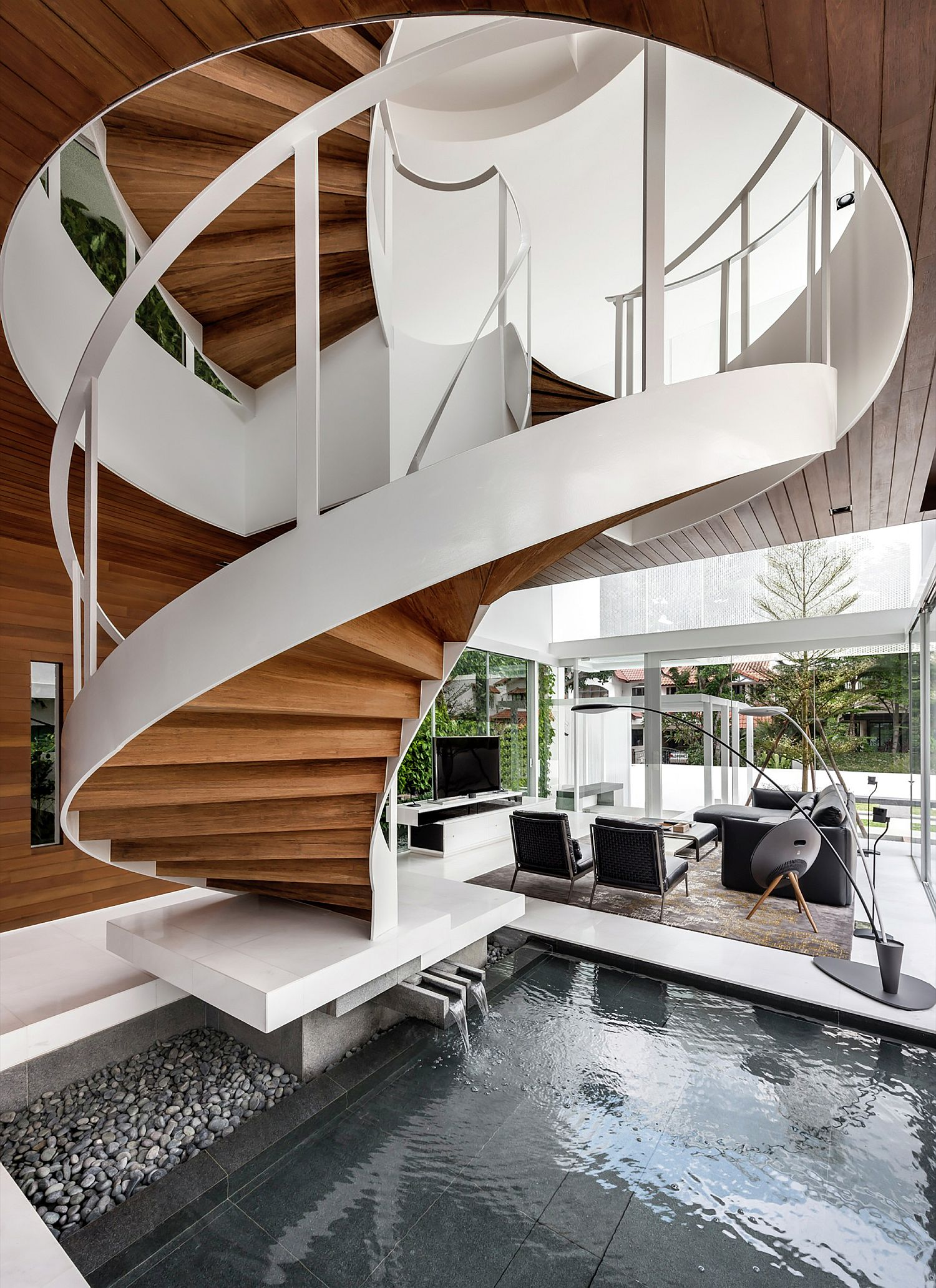 Stunning central spiral staircase and pool of the house
