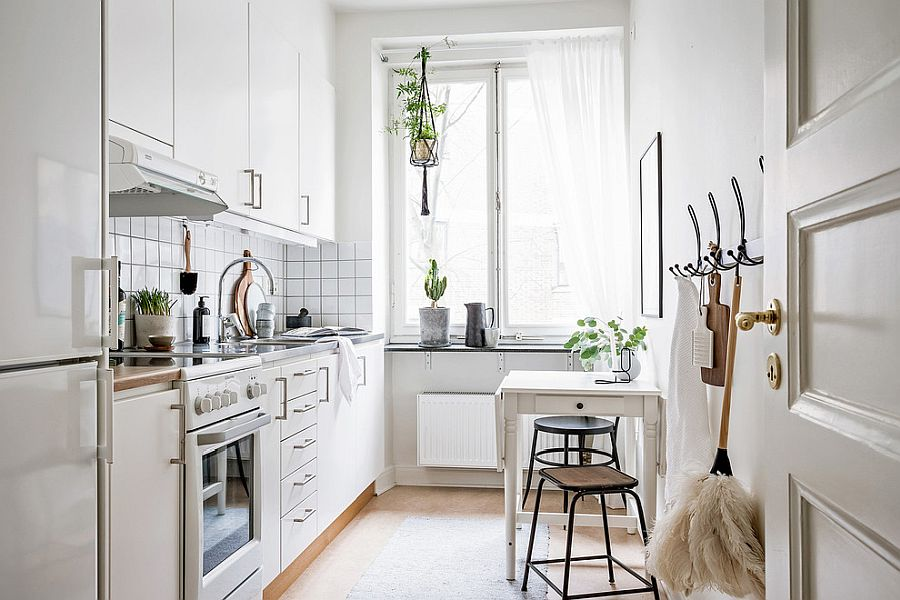 Tiny kitchen in white with pops of green and small breakfast zone