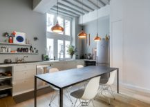 Trio-of-copper-pendants-along-with-the-window-lights-up-the-modets-kitchen-217x155