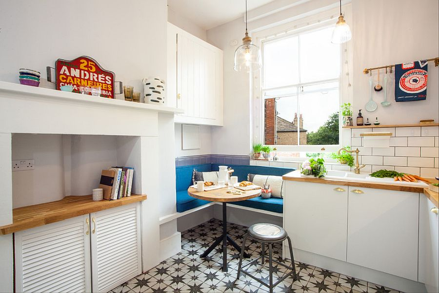 Ultra-tiny banquette in the corner used as breakfast zone for couple