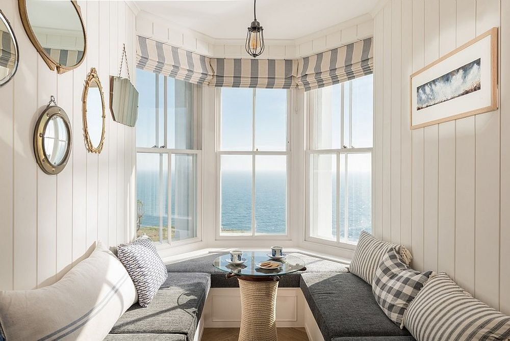 View outside the window adds to the charming coastal appeal of the dining room