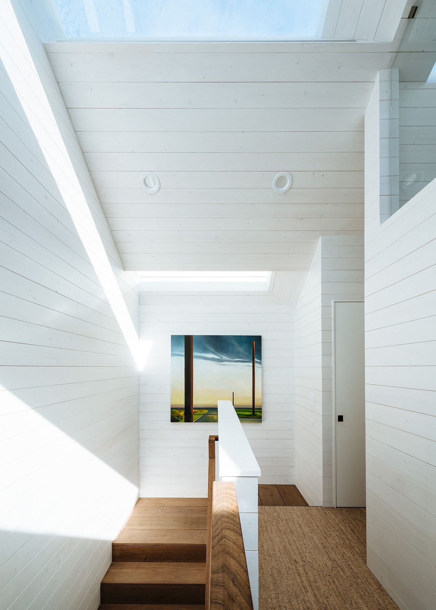 White and wood interior of the house with ample natural light