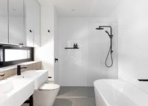 All-white-bathroom-of-the-house-with-pops-of-light-wood-and-black-thrown-into-the-mix-217x155