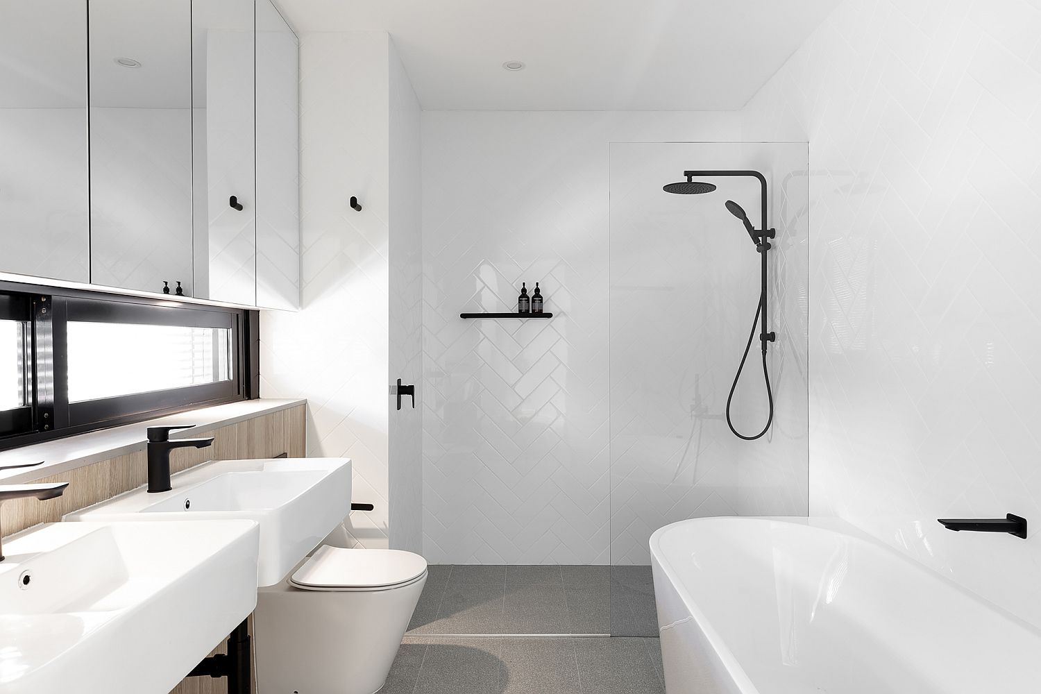 All-white-bathroom-of-the-house-with-pops-of-light-wood-and-black-thrown-into-the-mix