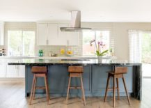 An-accent-island-in-bluish-gray-for-the-transitional-kitchen-in-white-and-gray-217x155