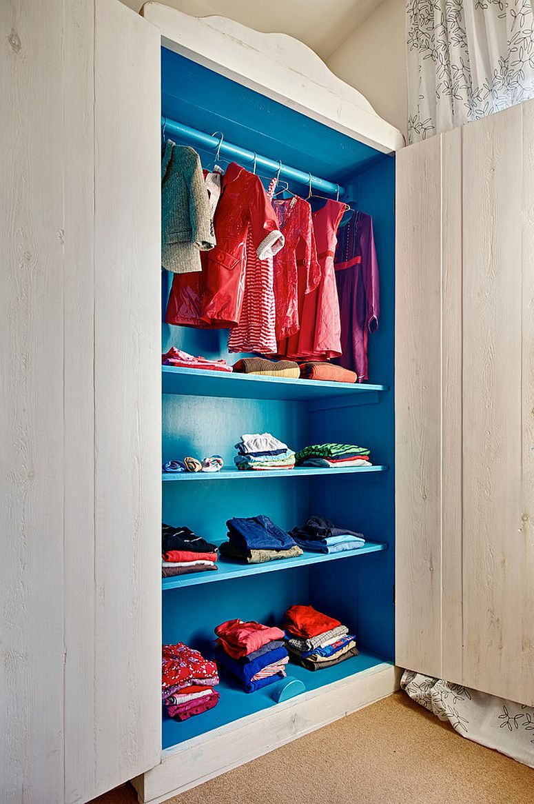 Beautiful blue closet in the bedroom adds color to a neutral setting