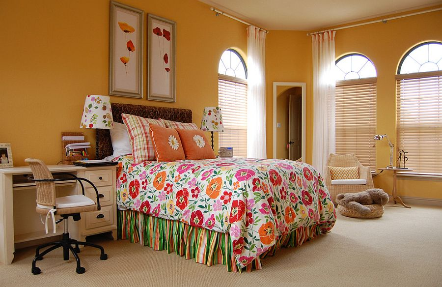 Bedding brings flower power to this dashing yellow bedroom