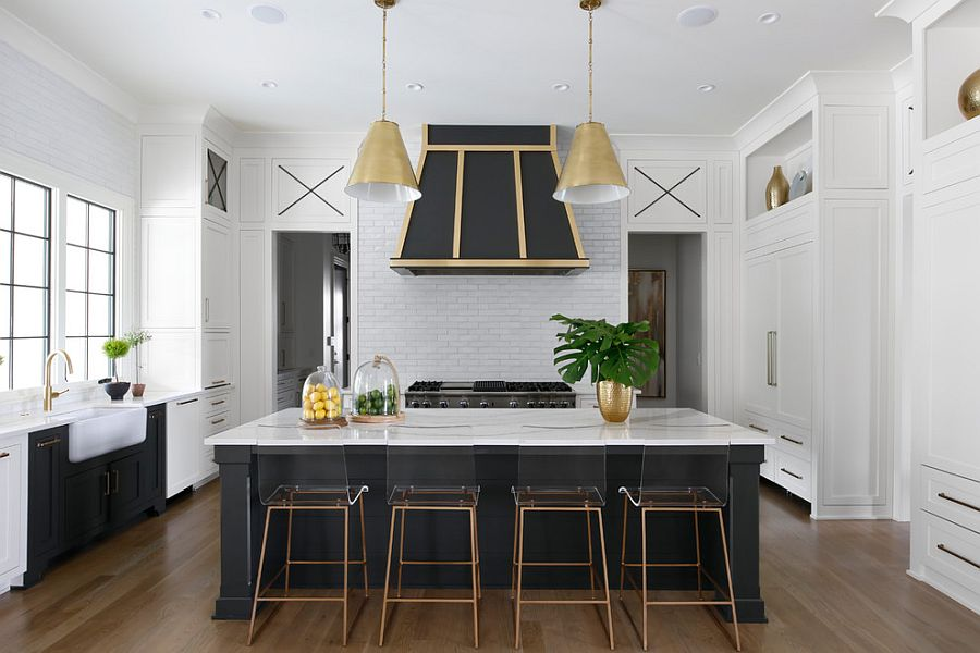 Black and brass used in the white becah style kitchen as an accent addition
