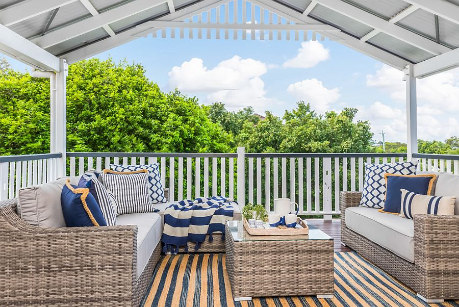 Blue accent pillows for the beach style covered deck
