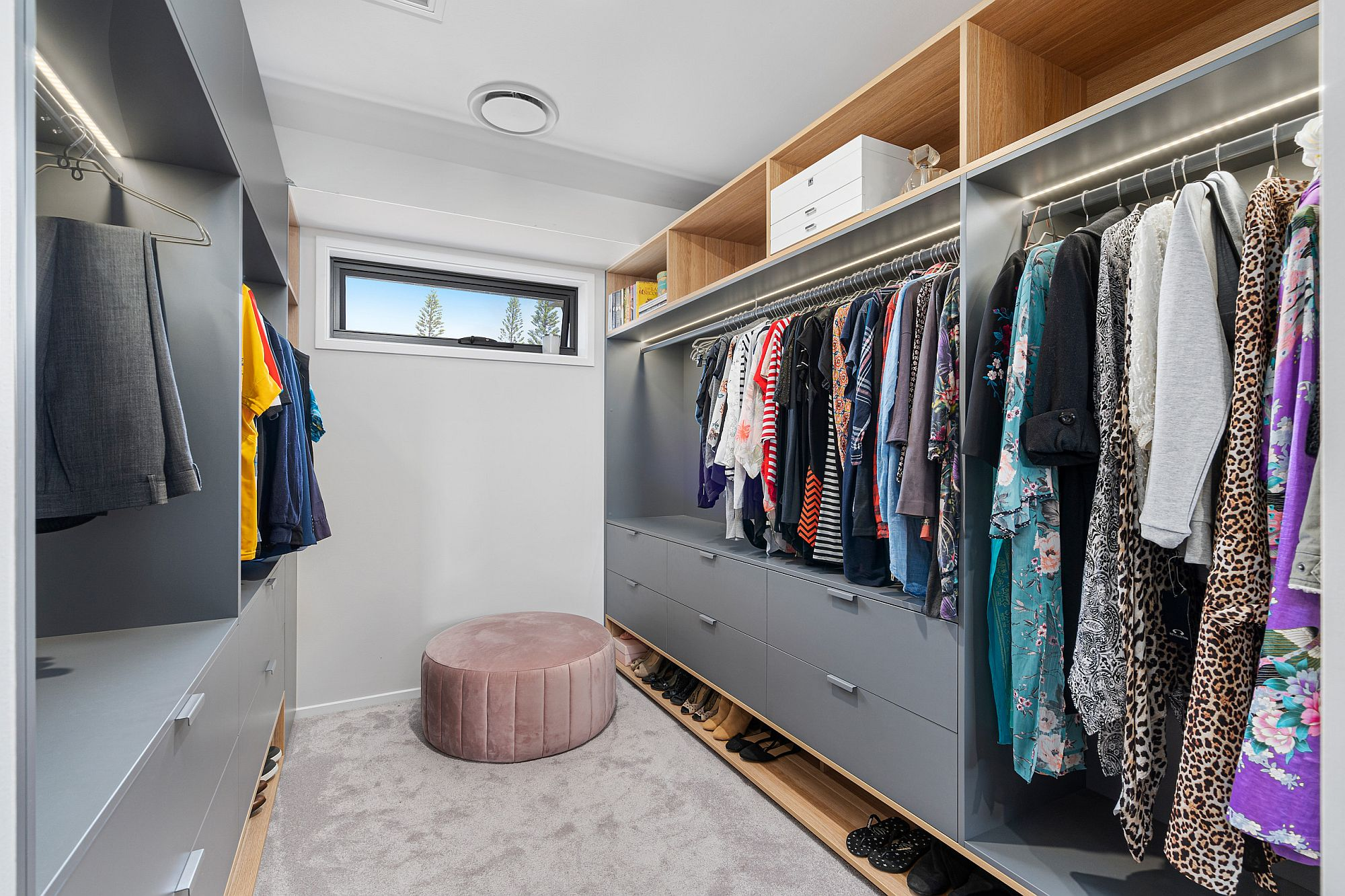 Bluish-gray and wood used in the small and spacious closet