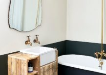 Brass-faucets-and-fixtures-make-a-big-visual-impact-in-this-bathroom-217x155