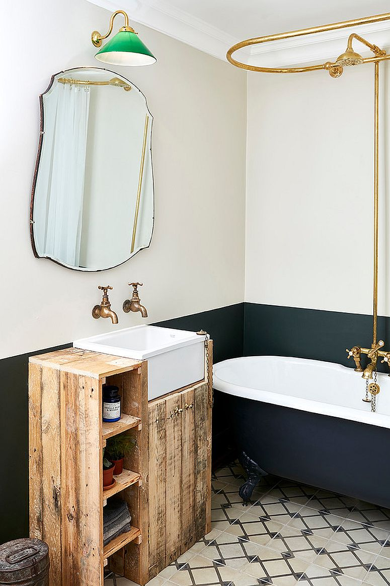 Brass faucets and fixtures make a big visual impact in this bathroom
