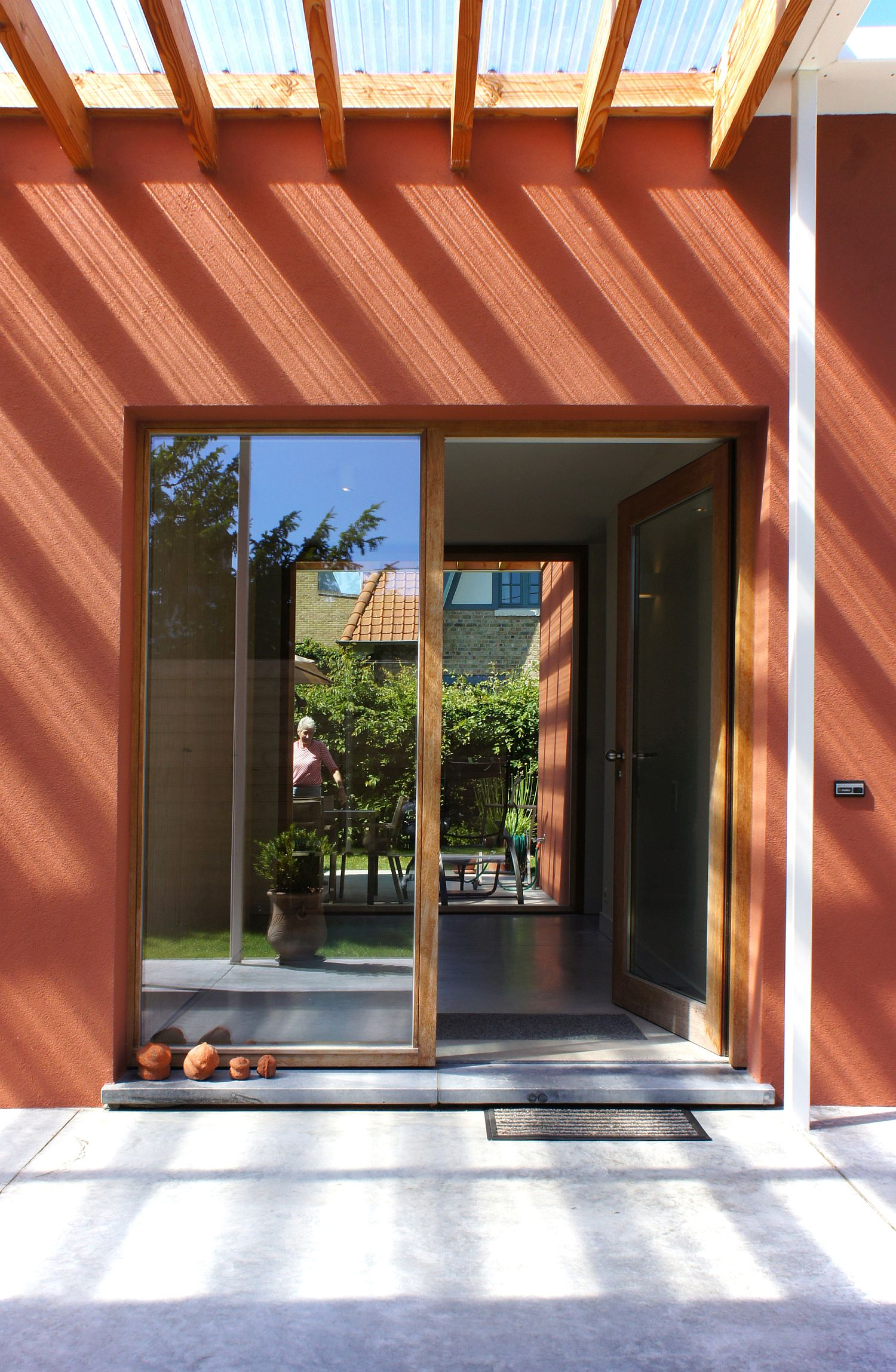 Bright orange exterior with reddish tint gives the home a Moroccan appeal