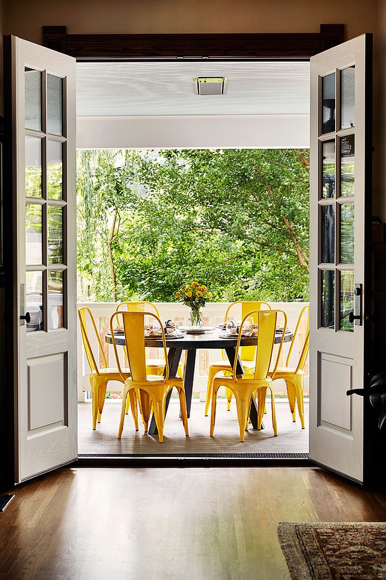 Brilliant chairs in yellow bring color to this outdoor dining space