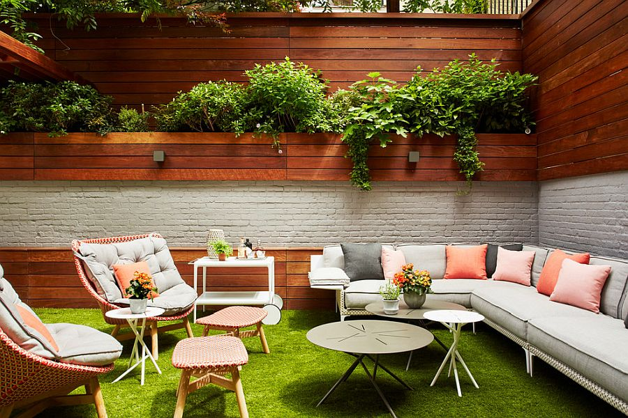 Captivating outdoor hangout in brick, wood and ample greenery all around