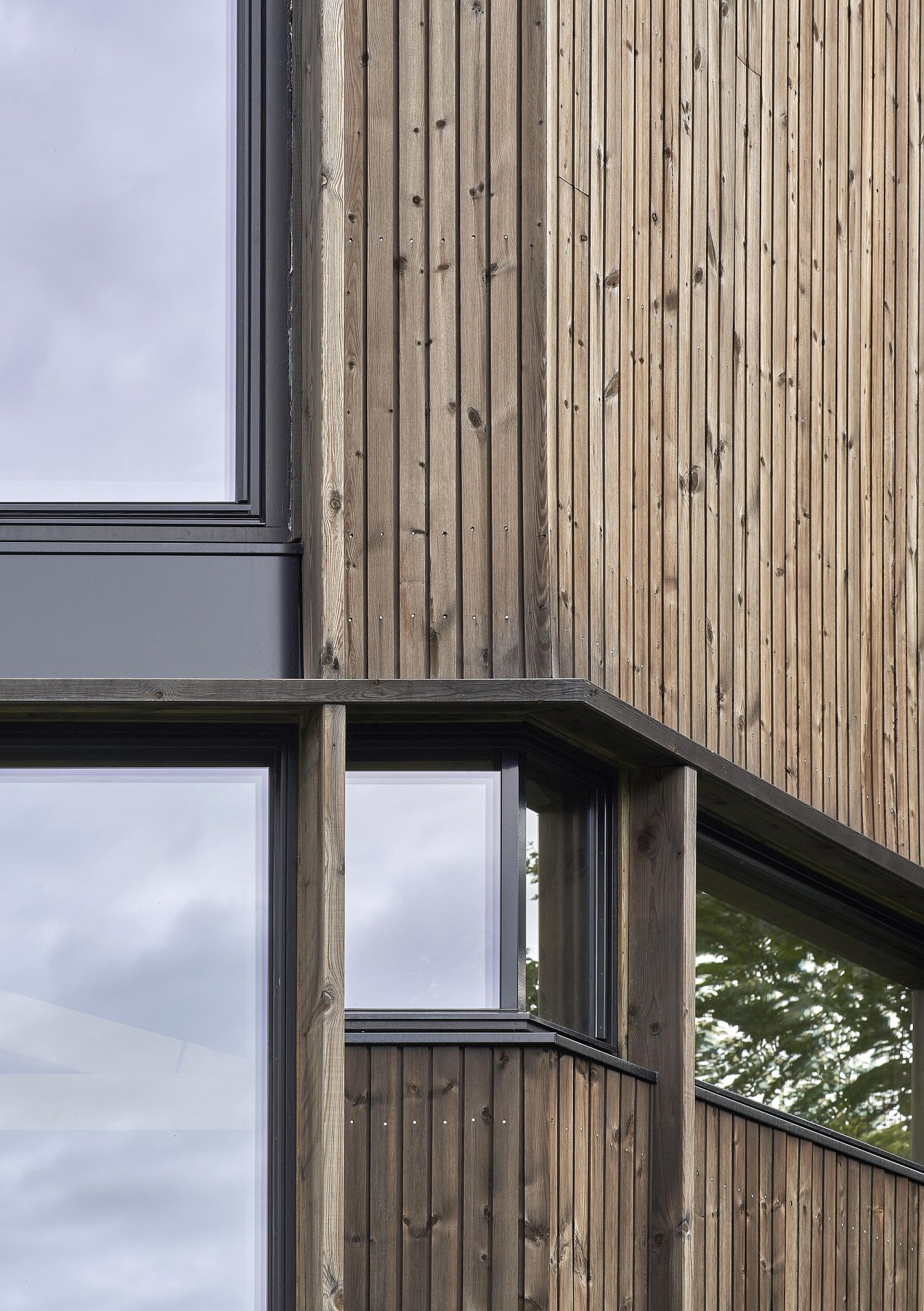 Closer look at the glass and wood home exterior