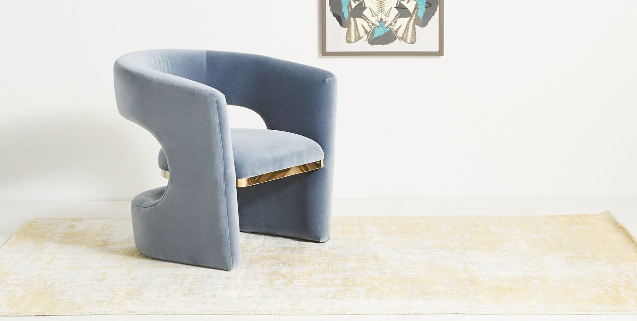 Deco-style accent chair with brass detailing