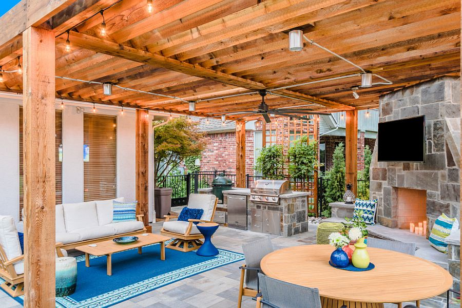 Decor, accents and the rug add delightful blue to the curated patio