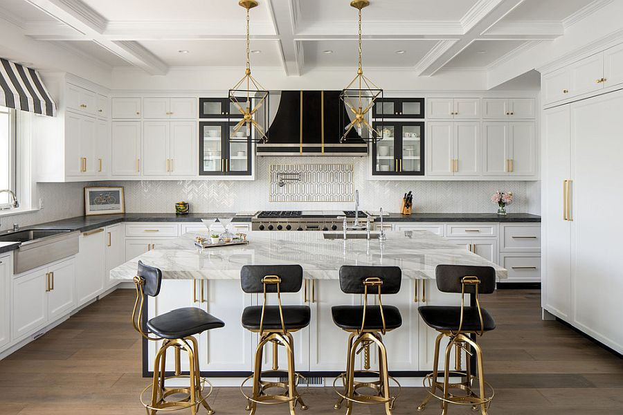 Delightful black and brass bar chairs steal the show in this largely white kitchen