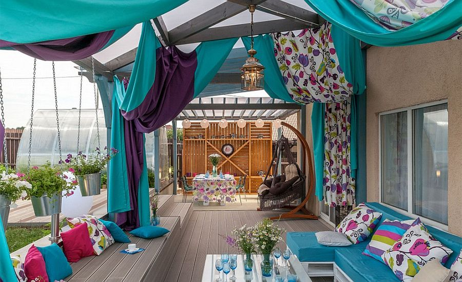 Drapes and curtains add to the color scheme of this eclectic deck