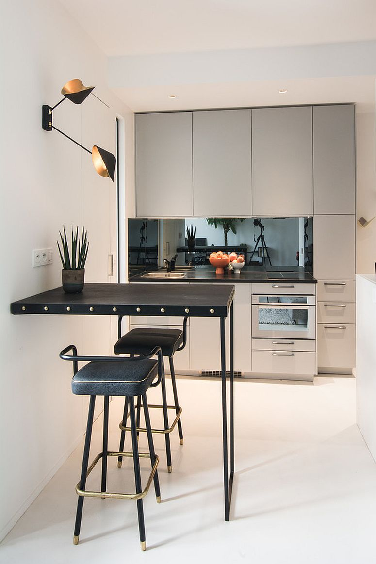 Ergonomic-and-space-savvy-kitchen-inside-small-Paris-apartment-with-modern-style