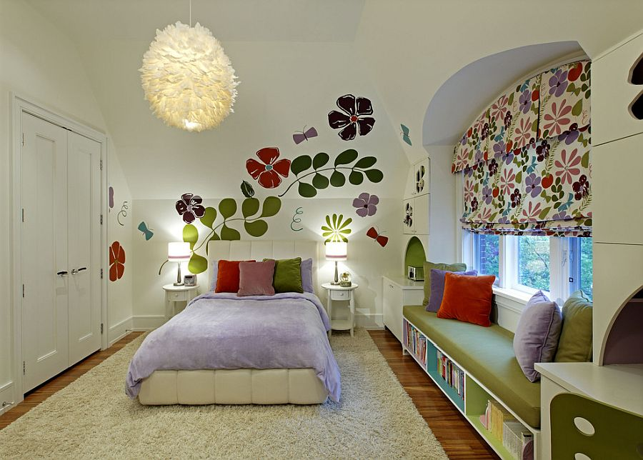Flower wall decals coupled with shades that feature a matching motiff in the kids' room