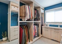 Gender-neutral-closet-with-a-simple-design-in-wood-217x155